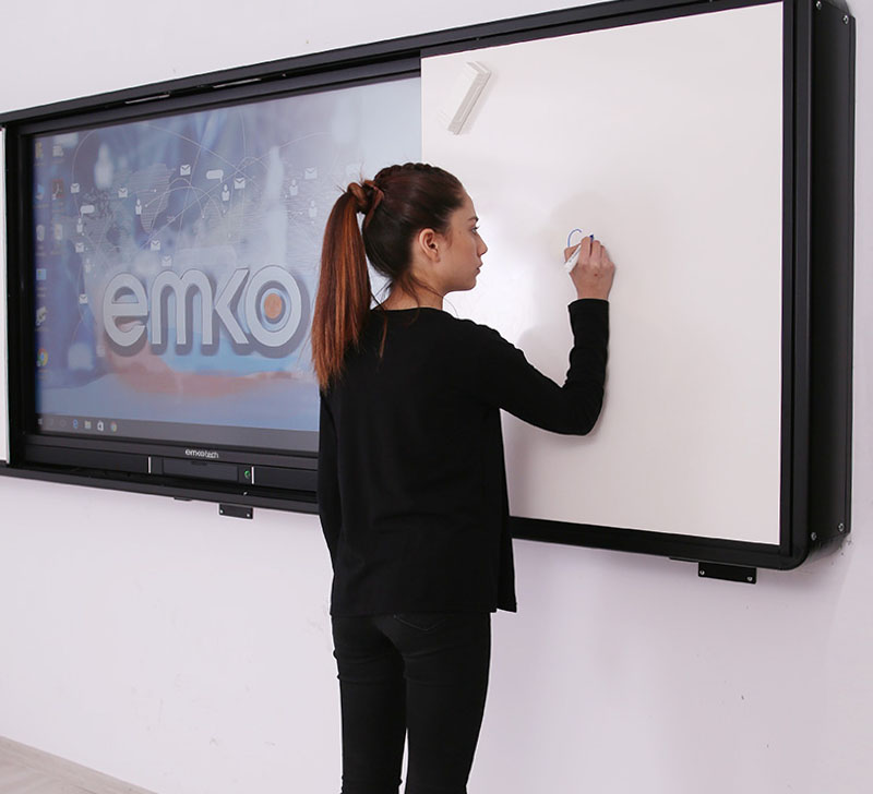 Girl writes on the whiteboards of Emkotech Sliding Board System